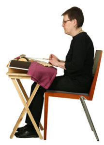 Nyplääjä ergonomisessa asennossa